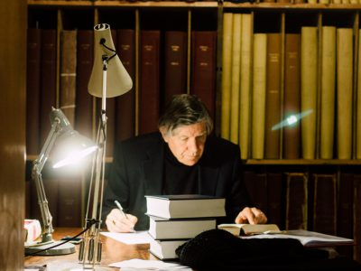 Man reading books in the library