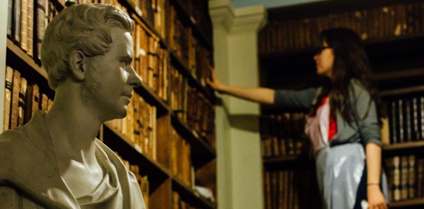 Lady looking at bookshelf